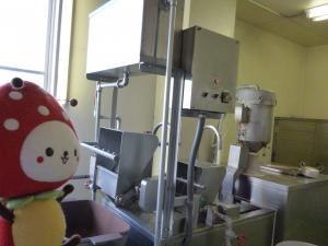 お米を洗う機械の写真